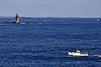 Ram Island Lighthouse and a Passing Lobster Boat.